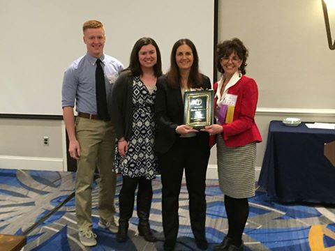 Dr. Marcie Taylor-Thoma, President of MSCSS, presents CCT professor Dr. Diana Owen with the Daniel Roselle Award